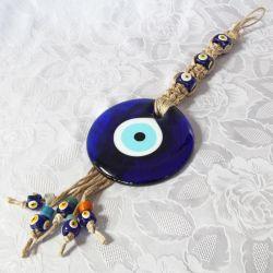 Oeil porte-bonheur sur tresse macramé (50 cm)